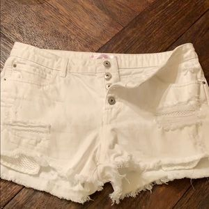 Distressed white denim button fly shorts